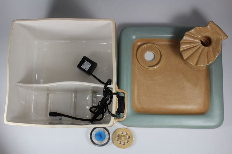 Square pet fountain with shell spout and internal battery