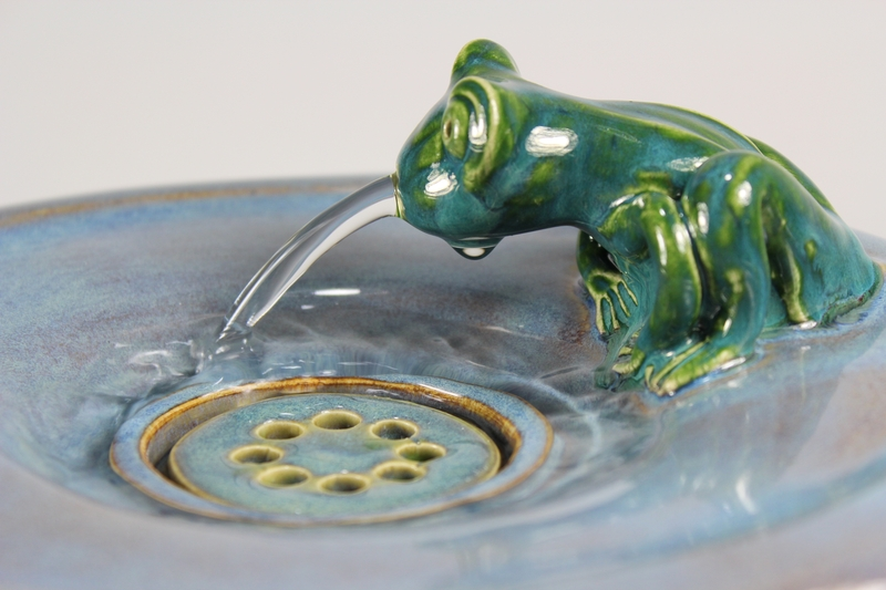 pet drinking fountain with a large secured coon lid and frog spout