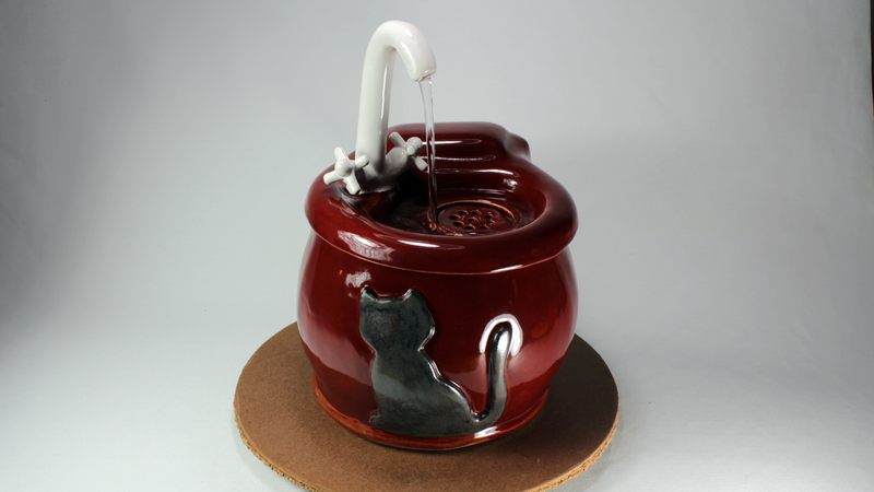Small cordless pet fountain with faucet spout and internal battery