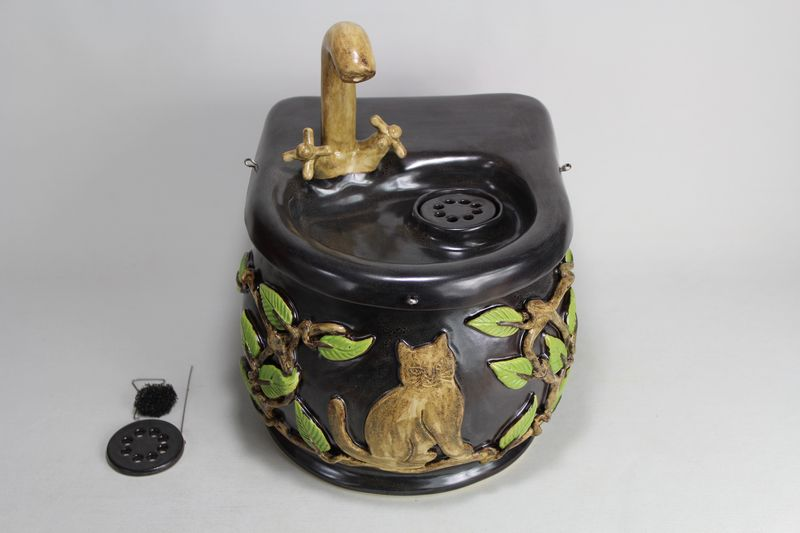 Small cordless pet fountain with faucet spout and internal USB battery